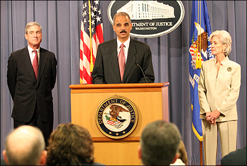 Officials announcing the indictments included, from left, Robert Mueller, FBI DIrector; Eric Holder, Attorney General; and Kathleen Sebelius, HHS Secretary.