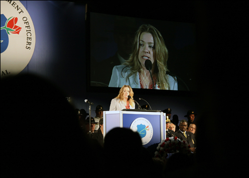 Jennifer Thacker—who also addressed the crowd of hundreds of family members and friends of officers killed in the line of duty, fellow officers, and law enforcement supporters—is national president of Concerns of Police Survivors, a group dedicated to helping families and co-workers of slain officers rebuild their lives.