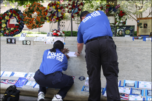 Unity Tour representatives make an etching of the name of a fallen comrade from the wall at the National Law Enforcement Officers Memorial.