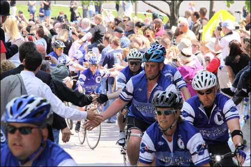 The bicyclists, some who began their ride hundreds of miles away, are greeted enthusiastically by family, friends, and other supporters as they arrive at the National Law Enforcement Officers Memorial