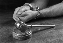 Man with handcuffs and gavel